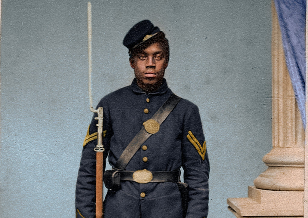 This is a colorized historic photo of a United States Colored Troop Soldier