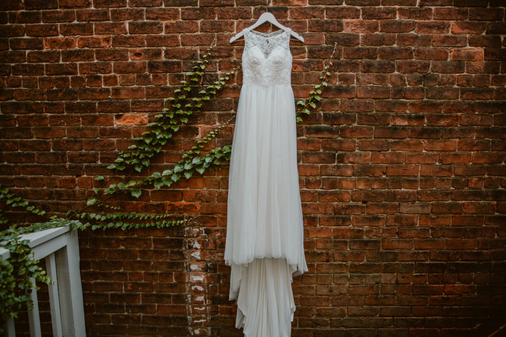 Wedding Dress Hanging on Bricks