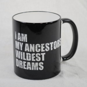 "Black mug with the logo in white "" I Am My Ancestors' Wildest Dreams"""